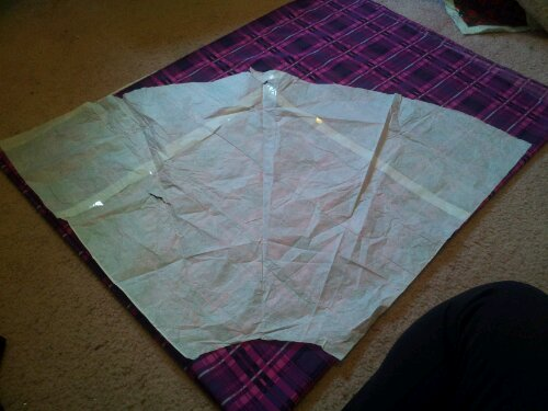 Plaid fabric with my pattern laid out.